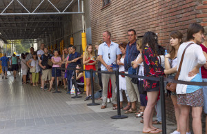 BARCELONA, SPAIN-SEPTEMBER 18: Long queue of people for ticket to La Sagrada Familia - the impressive cathedral designed by Gaudi, which is being build since 19 March 1882 and is not finished yet September 18, 2014 in Barcelona, Spain.